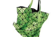 BAO BAO Issey Miyake: the high-tech bag / Starting from a traditional principle such as the origami, and form a primary inlay, the Issey Miyake Maison develops a prototype with unlimited plastic potentials. The PVC plates joined together with new mathematic-textile techniques, shape a changeable accessory, that model itself according to its content, to the way how is wore, or even just how is put down. In a constant game of shapes and reflections, the colours are enhanced by the gleams that the PVC itself catches and reflects.