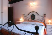 Appartment Fasanella / Fasanella is the name of a local wind. The flat is especially refined because of its original stonewalls. Furnished in a classical style with a wrought iron bed and the use of a sofa bed, it has a relaxing atmosphere. This flat was originally the ancient stable. It was a place for meetings, work and play during the cold winter months for family members, due to the presence of the farm animals. (accommodates 4 people) www.cascinacrocelle.it