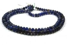 Natural Iolite Gemstone Beads / Get the best natural Iolite gemstone beads from African Mines. Available in clear smooth beads. A bead measures from 6mm to 10mm. These beads are unbleached,real,untreated & beautiful which allure you.
