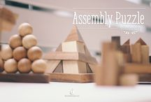 Assembly Puzzles / Assembly Puzzles: History by SiamMandalay.  http://shop.siammandalay.com/blogs/puzzles/51256835-the-history-of-assembly-puzzle-put-together-brain-teasers