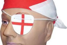 Seasonal: St Georges Day - England Party Supplies / Our St Georges Day range of outfits and accessories is also used by England Football Supporters. St George's day party supplies, Red & white Plates, napkins, cups, England Red & White flags, party decorations and fancy dress costumes.   Saint George's Day is celebrated in England on the 23rd of April to commemorate the Patron Saint. St. George. He was famous for fighting a fire-breathing dragon to save a maiden, so in this category you will find knight costumes and dragon fancy dress.