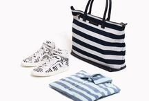 Striped Out / Give your vacation style a jumpstart, as nautical stripes get blown up and exaggerated for spring. From big bold lines to playful regatta stripes, everything from sneakers to sweatshirts, blazers and swimming trunks have been covered in graphic strokes in summer-ready shades. Keep your stripes grounded by pairing them with neutral shades of navy, khaki or white. For those intent on earning their style stripes this season, add floral prints to the mix for a chic sartorial clash.
