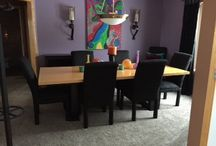 Dining Room / Photo of a contemporary dining room with plush carpet and purple walls.