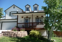 CHELSEA Ct Elizabeth, Colorado 80107 / Charming home on large lot!*3 bed/2 bath plus small bedroom & bath w/shower in finished basement*Nice kitchen & dining area, opens to deck*Large deck with view, great yard*Delightful front porch