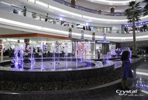 Al Ghurair Centre- Dubai, United Arab Emirates / Drawing people into the atrium with its colorful sequencing, the water feature at Al Ghurair Centre functions as popular social gathering space where patrons wait for its show to culminate with a spectacular burst jet.  / by Crystal Fountains