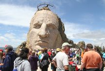 Volksmarch / The annual Crazy Horse Volksmarch is a 10k (6.2 mile roundtrip) hike up to the world's largest mountain craving in progress. Traditionally held the first full weekend in June every year, the first Fall Volksmarch will be held in 2013.