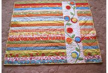 Quilts from precuts / Patterns for jelly rolls, pixie strips, layer cakes, nickels and dimes, charm squares, etc.