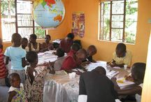 Education / Photos of children sponsored through Partnership Uganda by US sponsors reading, writing, and learning in Bulumagi.