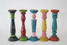 Wooden Pillar Candle Holders / These charming Wooden Pillar Candle Holders will add a splash of color to your room and brighten up your setting. The Pillar Candle Holders feature brilliant contrasting colors and detailed embossed floral pattern all round.  Available at www.marktsq.com