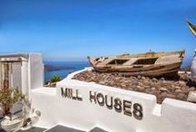Sywawa | Mill Houses Boutique Hotel / Mill Houses Boutique Hotel & Suites in Santorini, looks like hovering over the mesmerizing cliff. With a unique view to the volcano of Santorini – the symbol of power of a sea that historically united cultures – our hospitable suites seem entangled in an indiscernible dialogue with the mythical elements of the island.   Experience excellence and premium services in Millhouses boutique hotel.