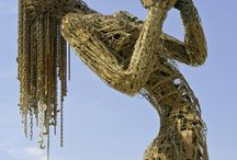 ARTES Ecstasy Hayes Valley, San Francisco / Ecstasy, a 28-foot-tall figurative sculpture made from reclaimed steel, embodies the emotion of passion and the posture of exaltation it can inspire. She is illuminated at dusk