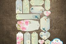 Colored die-cut miniature embellishment for scrapbooking