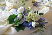 A wedding of BLUE / This bride wanted blue & white flowers. We used blue hydrangeas as the foundation flower with accents of white dahlias, white lilies, cream roses, Queen Anne's lace, light blue delphenium, white stock and white snapdragons.