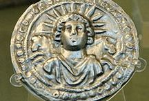 "Images of SOL INVICTUS (Helios) / Sol Invictus (""Invincible Sun"") was the official sun god of the later Roman Empire. In 274 the Roman emperor Aurelian made it an official cult alongside the traditional Roman cults. Scholars disagree whether the new deity was a refoundation of the ancient Latin cult of Sol,[1] a revival of the cult of Elagabalus or completely new. The god was favored by emperors after Aurelian and appeared on their coins until Constantine. The last inscription referring to Sol Invictus dates to 387 AD. / by Leslie Greene"