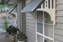 Cottage Farmhouse Windows / Ideas to create shade over the windows (and keep the house cooler), DIY shutters, window flower boxes, and molding for curb appeal.