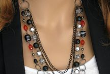 Multiple strand necklaces