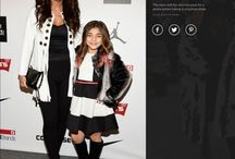 Teresa Giudice wearing an Eva Varro White Fringe Jacket! / Teresa Giudice from the Real Housewives of New Jersey at New York Fashion Week Fall 2016 wearing an Eva Varro White Fringe Jacket!