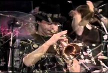 """Chuck Mangione / Charles Frank """"Chuck"""" Mangione (play /mændʒiˈoʊni/; born November 29, 1940) is an American flugelhorn player and composer who achieved international success in 1977 with his jazz-pop single, """"Feels So Good."""" Mangione has released more than thirty albums since 1960."""