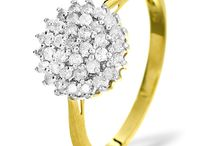 Diamond Cluster Rings / With multiple diamonds and astonishing sparkle, we've created diamond cluster rings that outshine all others. These skillfully handcrafted designs are impressive and glamorous.