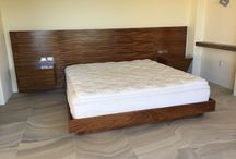 Beds and Bedroom Furniture / Modern platform bed handcrafted in Parota wood. Night tables are integral.