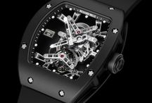 """Tourbillon Watches / A tourbillon (pronounced """"TOUR-bee-yon"""") is a complication that provides greater precision in the timekeeping of a mechanical watch by protecting those parts.  For centuries, watches with tourbillons have been the pinnacle in watchmaking. Now, one can simply buy a watch with a tourbillon mechanism from China."""