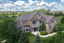 68 Tournament Drive N - Hawthorn Woods, IL. 60047 / $985,000 - With 4 bedrooms, 3.5 bathrooms & a 3 car garage, this home has flexible floor plan to suit your every need.  Prepare meals in your gourmet Cook's kitchen while using high-end stainless steel appliances, serve meals on your granite island, store ingredients in your large pantry or relax in your 2 story family room with wall to ceiling windows. Enjoy views from the wrap around custom built 2-tier deck!  Retreat to your master suite with tray ceiling & walk- in closet.