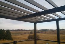 """Maintenance Free Aluminum Pergola / What a wonderful view from this second story deck that features several Craft-Bilt products: aluminum decking & railing, LED sconce lights, our extruded vinyl pergola beams and a custom pergola frame made with our 5½"""" columns & beams. More pictures to follow."""
