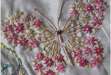 Butterfly made by satin stitch French knot stem stitch lazy daisy stitch love it