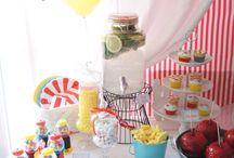Fun Fair Party / Fete Foraine / Sweet table pour l'Aïd El Kebir sur le thème de la fête foraine.  #carnivalpartytheme #birthdayparty #funfair #feteforaine #blue #red #yellow #funfairsweets #funfairsweettable #sweettablefeteforaine #pommesdamour #popcorn #ballons #balloons #cupcakes #beignets #barbeapapa #cakepop #candycotton