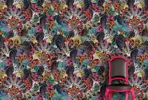 SANTORUS Wallpaper / Find a whimsical carnival of processing animals amongst a menagerie of feathers, embellished ferns, and exotic rainforest canopies displayed in a dramatic colour palette of Indian spices and richly lavish hues.