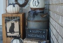 Halloween Chic Front Porch / ideas to create a chic Halloween front porch.  Give your haunted house a bit of  dark curb appeal before the big day,.