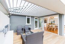 Rear extensions to villas
