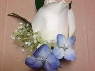 Boutonnieres by Royal Fleur Florist