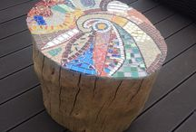 Outdoor Table or Chair on Castors / Salvaged Tree Stump Repurposed with Lovely Mosaic Top and Castors for moving it around easily.