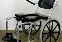"""(SP-A) COMMODE 'N SHOWER CHAIR w/ 20"""" WHEELS - ADJUSTABLE / The """"Go-Anywhere"""" Chair SP-A® is designed to be the most versatile commode shower wheelchair anywhere. With a maximum width of just 23-1/2"""", this commode/shower wheelchair may pass through even narrow doorways."""