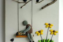 pebble art child father on swing