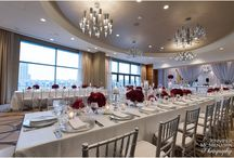 Silver & Red Roses Wedding Reception in Baltimore / Red rose florals contrasted with silvery table linens and tabletop decor present a stunning wedding reception tableau at the Four Seasons in Baltimore, Maryland. Elizabeth Bailey Weddings. Jennifer McMenamin Photography. Florals: Blue Vanda.  Linen Rentals: Gala Cloths.
