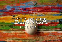 Bianca Colors / Din cele sase baze exceptionale UCIC Bianca (Bianca Solo, Bianca Argento, Bianca Oro, Bianca Solo Vulcano, Bianca Argento Vulcano si Bianca Oro Vulcano) se formeaza Bianca Colors, cu noi si incantatoare nuante decorative: culori si tonalitati surprinzatoare vor da viata peretilor dumneavoastra prin efecte uimitoare.