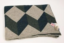 British Woollen Blanket / My NEW British Woollen blankets are knitted for you in the home of British knitwear; Leicester and knitted from Yorkshire wool. My Tumbling Block blanket is inspired by a 3-D quilt block. My BIG Fair Isle blankets takes traditional Fair Isle patterns and enlarges them for visual effect. Both blankets are knitted in a muted colour scheme. These blankets are comfortably weighty and great to cosy up in, just like my quilts.