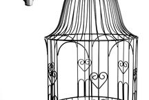 Hanging Baskets / Our creative forgers have produced an unrivalled and stunning range of durable, heavy grade Iron, and wire work, hanging Baskets. Our designs include the use of colourful Beads, sculpted leaves and many other original designs.