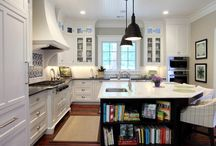 dark cabinets / Kitchen cabinets where a mixture of dark and light tones are used.