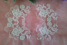 Carrickmacross / Traditional Carrickmacross Lace is a form of lace that may be described as decorated net. The lace is made up of netting, muslin and needle lace.