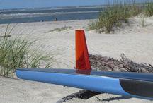 FSI Fins at Tybee Beach, GA.  FSI makes SUP fins and surfboard fins. / FSI WG2 fin in a race standup paddleboard at Tybee Beach, GA.