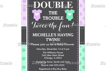 Double Trouble Twins Purple and Green Baby Shower / This design features two baby outfits in purple and green with a white heart in the center. The background is purple and green polka dots and a gray chalkboard with a dotted border.