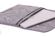 Laptop case / Olisko mahdollista: kuminauhalla tasku, joka laajenee. Muuten nätisti kiinni kyljessä, mutta ratvittaessa mahtuu laturi kyytiin.