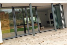 Aluminium Doors / Metal Technologys thermal range of Bi-Folding doors are the perfect solution to open up your home and bring the outside in, while keeping the elements out. Our Bi-Fold doors offer a wide range of designs from two to seven panes and up to 6 metres in width giving architects, clients and specifiers total design flexibility. The door can also be used in a single door application.