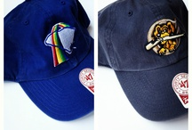 "Rainbows are pretty / A look at past.  The Charleston RiverDogs were the Charleston Rainbows from 1985 - 1993.  They were named after Charleston's historic ""Rainbow Row"" to celebrate the charm of the city."