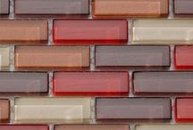 Designer Glass Mosaic Tiles / Glass tile and glass tile mosaics are available in many different styles and sizes. They can transform any design or project with beauty and function. It's no surprise then that they are popular in modern design and can be applied to many different areas including pool and spa applications since they are frost-resistant.