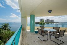 1683 S Bayshore Ct #401E-SOLD / $1,075,000 Calling all boaters! Incredible unobstructed Bay views from this 3 BR/2.5 BA (1,710 square feet per measurement) corner unit with 35' boat dock. Secure boutique building with  12 units. Private elevator entry, oversized wrap-around terrace, marble/wood floors, one covered parking space. Close to parks, Grove village, Brickell and downtown Miami. Carol Pawley 305 992 6188