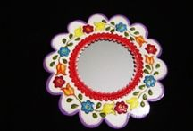 Painted Tin Mirror  / Add a splash of color, interest and old world Mexican style to your walls, would look great in any room. These beautifully painted, punched metal accent mirror for the wall are hand crafted in San Miguel de Allende, Mexico. Each comes ready to hang with a secure metal tab at back.